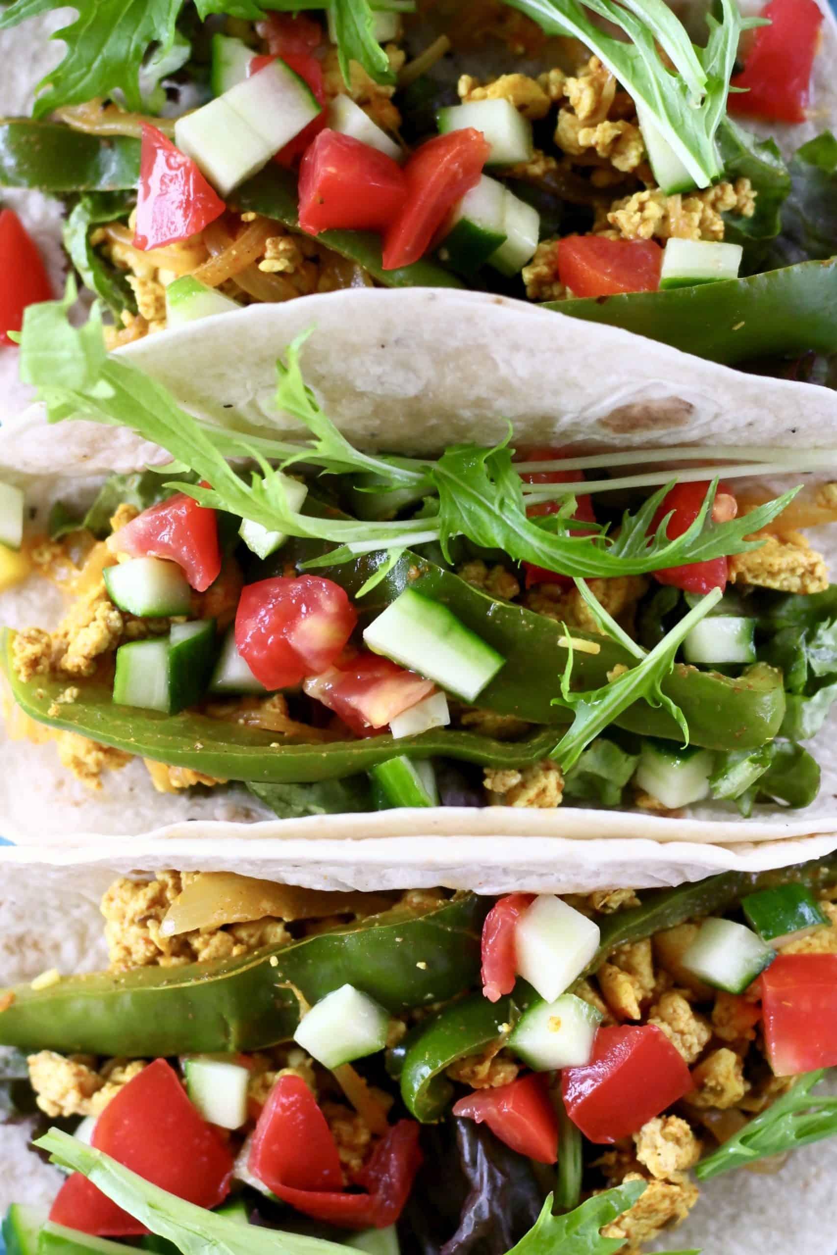 Three scrambled tofu tacos with salad