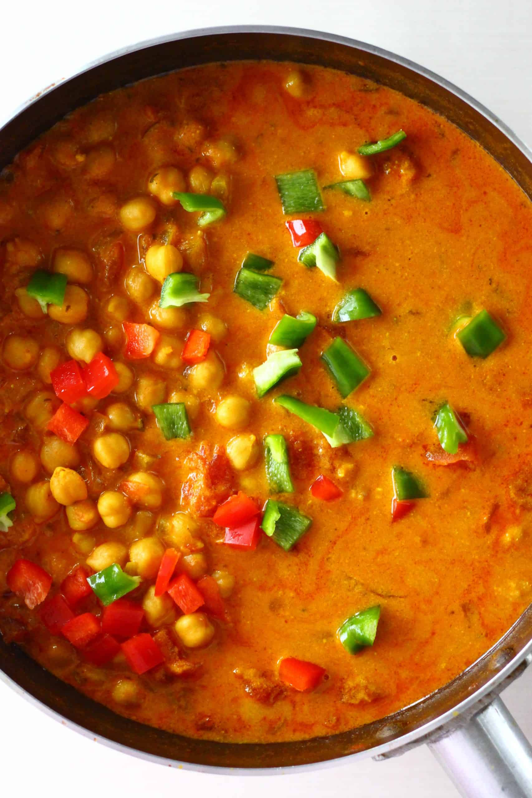Chickpea tikka masala in a saucepan with peppers