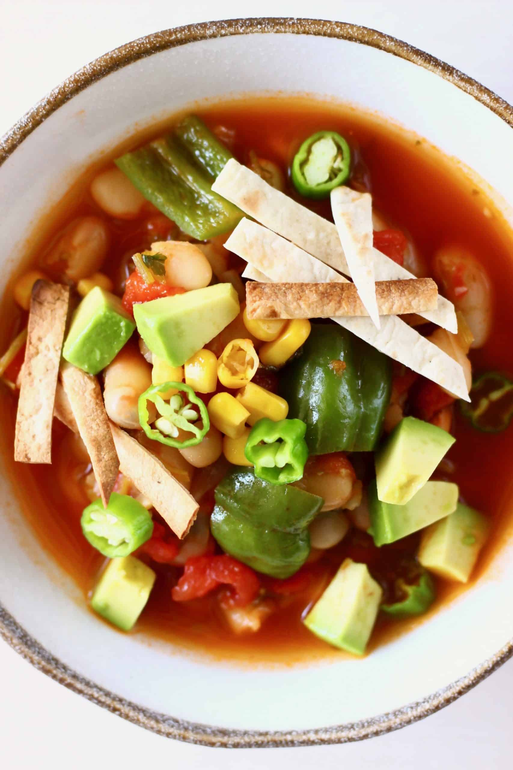 Vegan tortilla soup in a white bowl