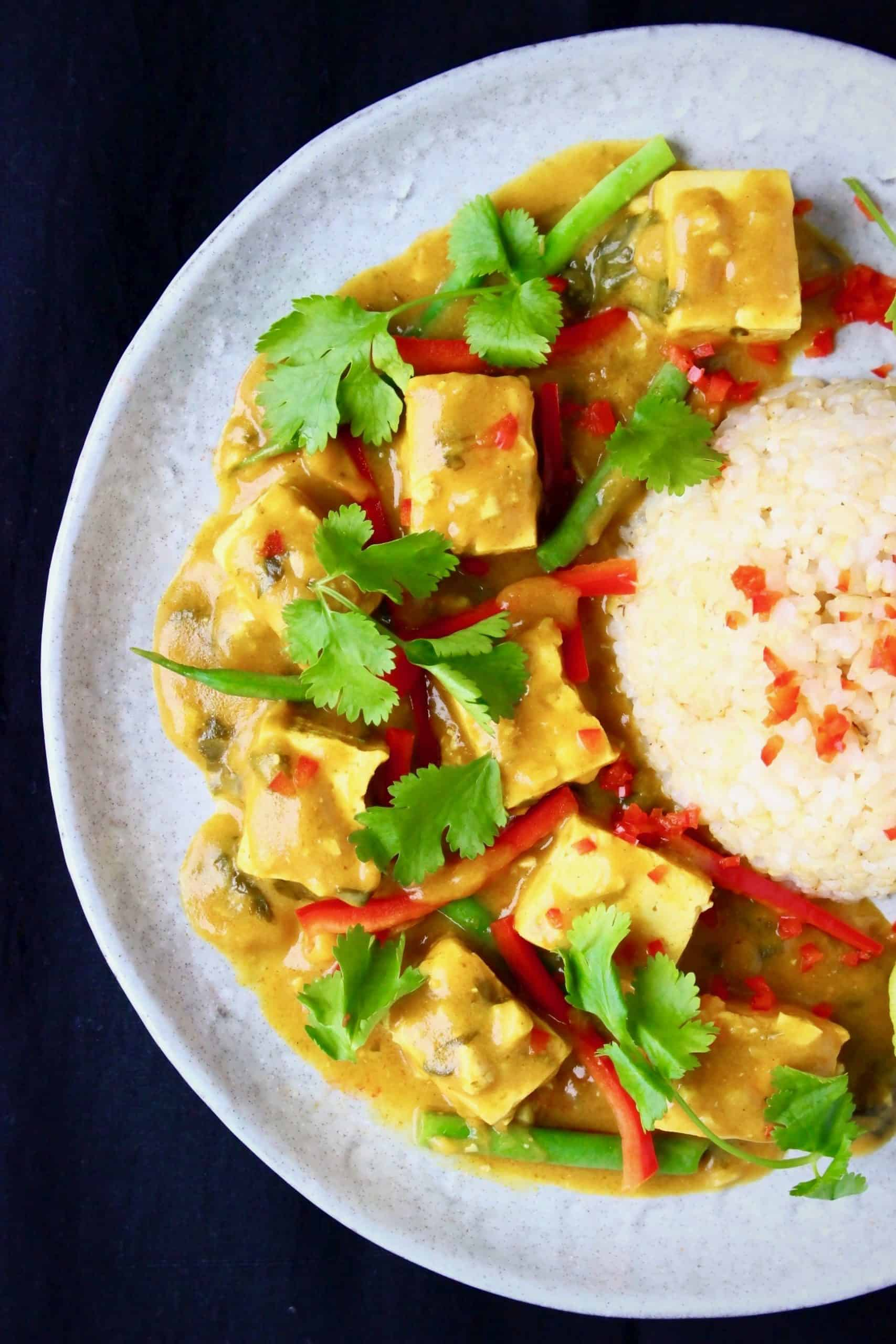 Tofu satay curry with rice on a plate