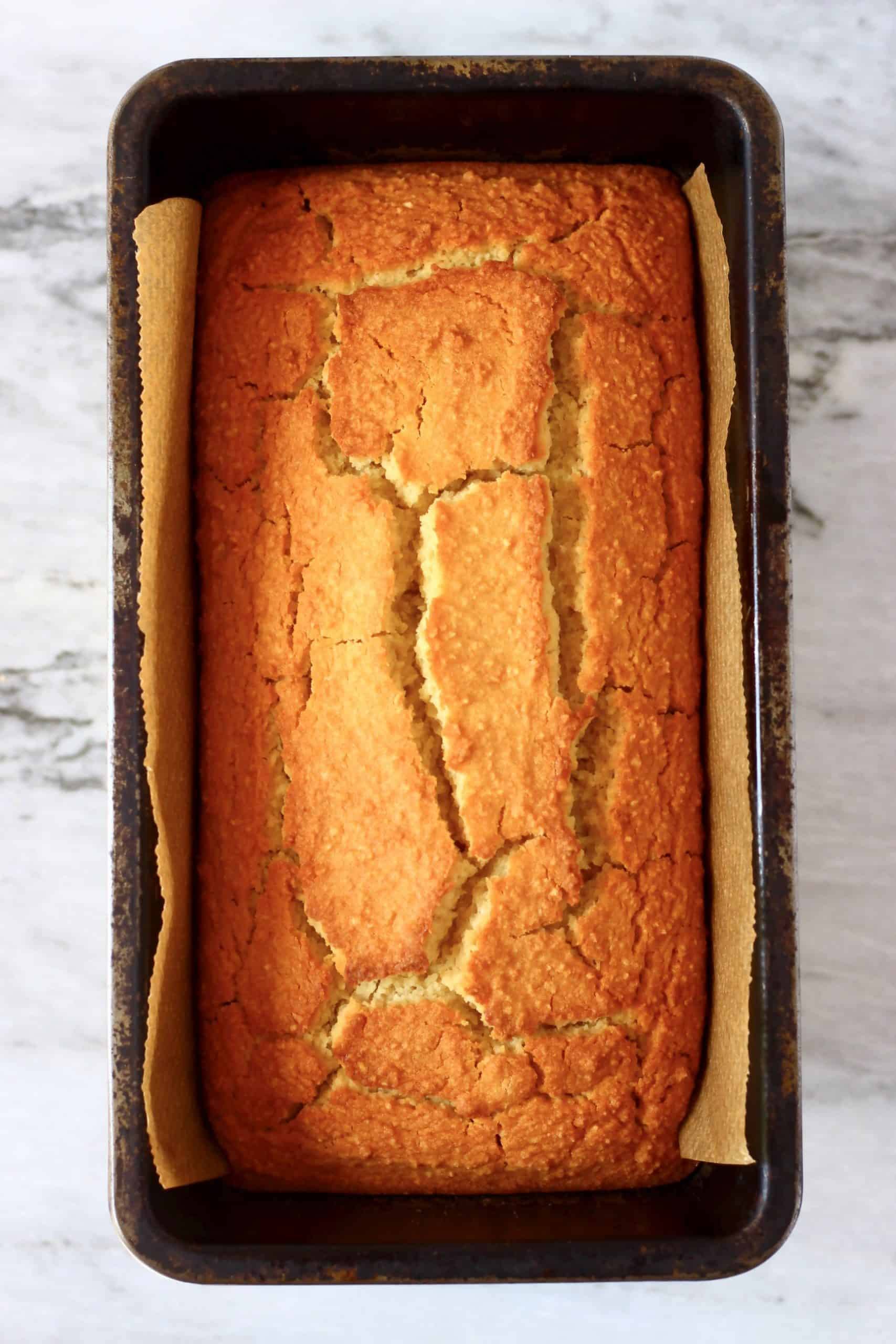 A loaf of vegan orange bread in a loaf tin