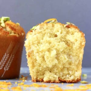 Two gluten-free vegan orange muffins, one cut in half