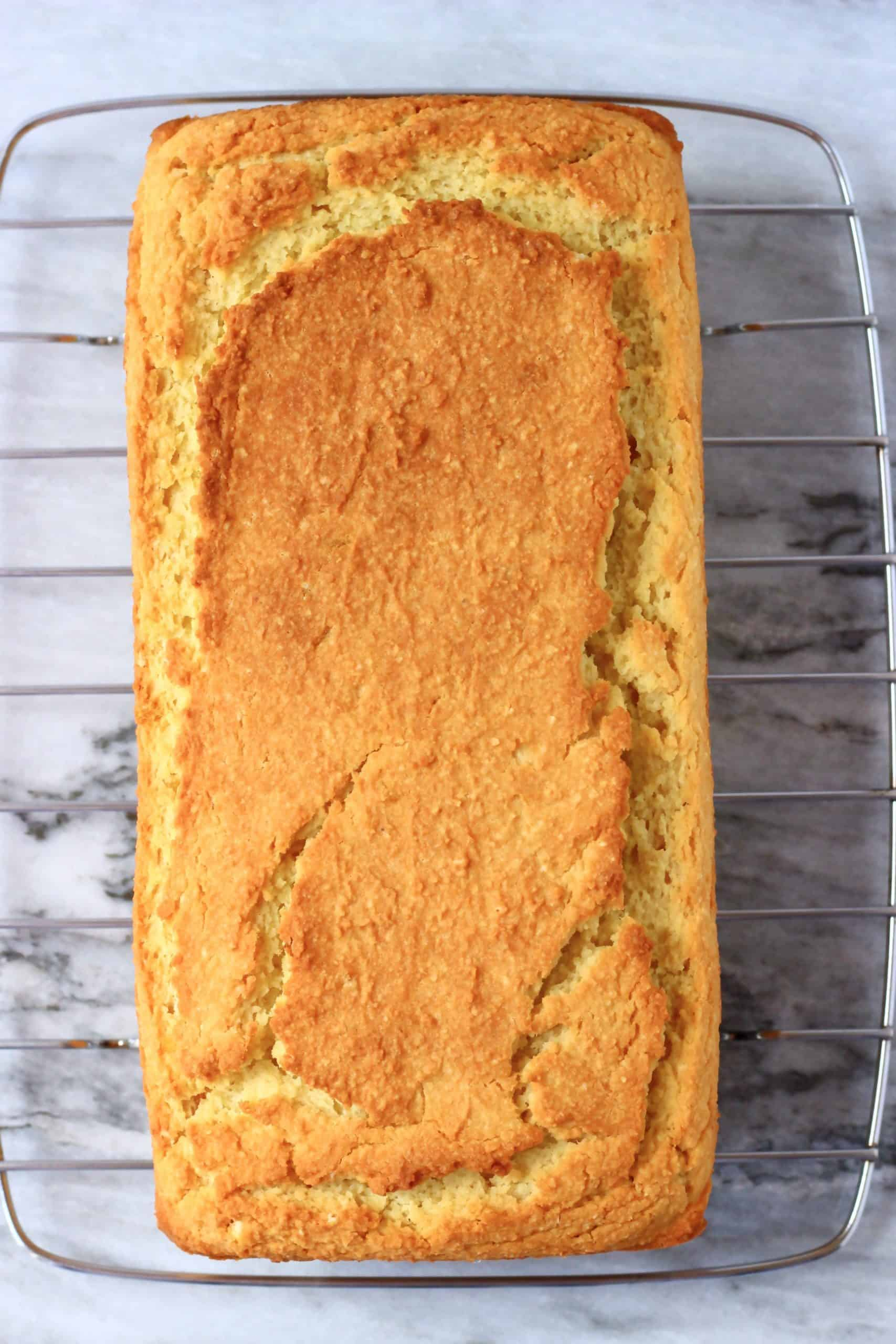 A loaf of gluten-free vegan orange pound cake on a wire rack