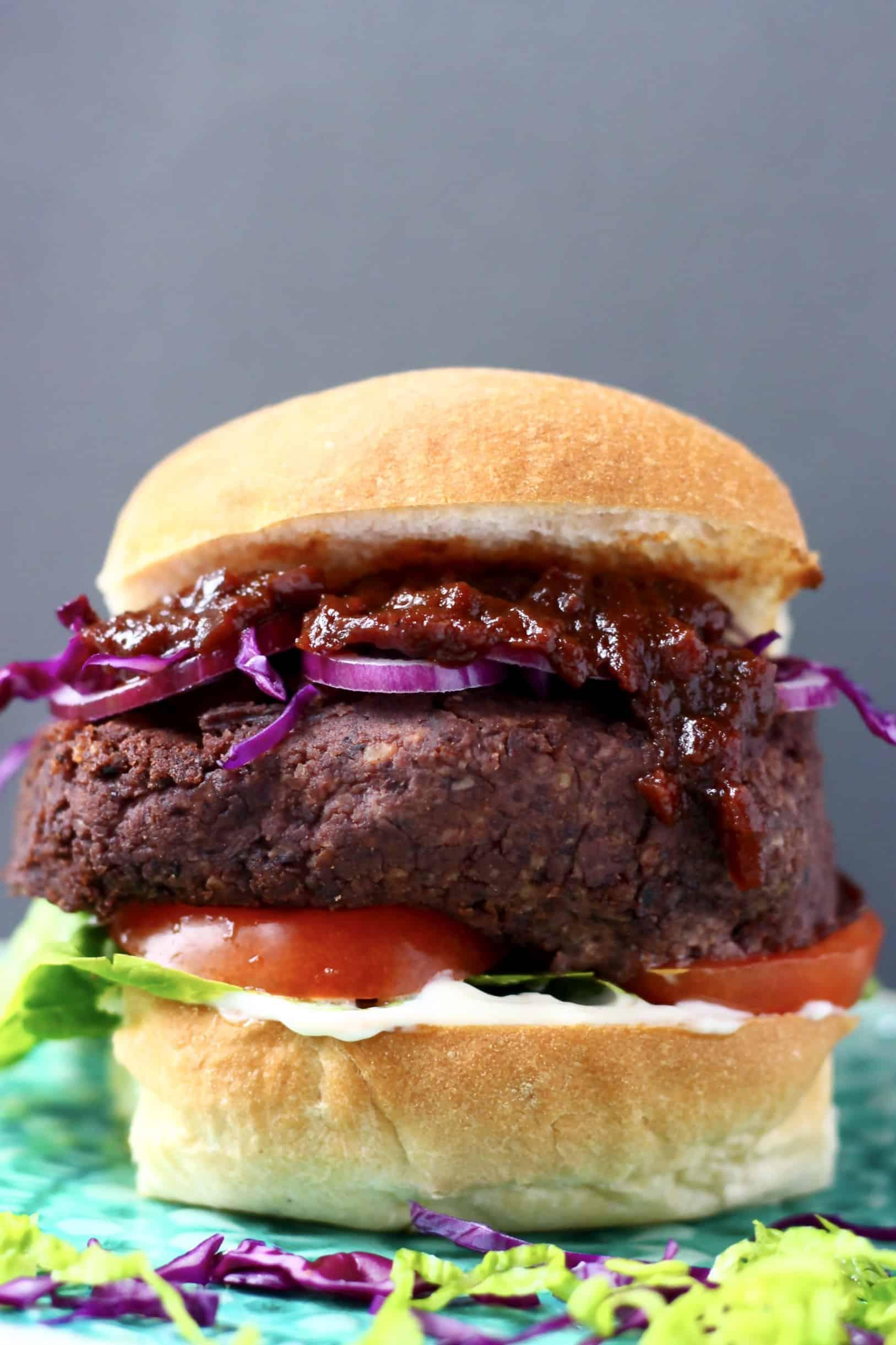 Vegan mushroom black bean burger with salad on a blue plate