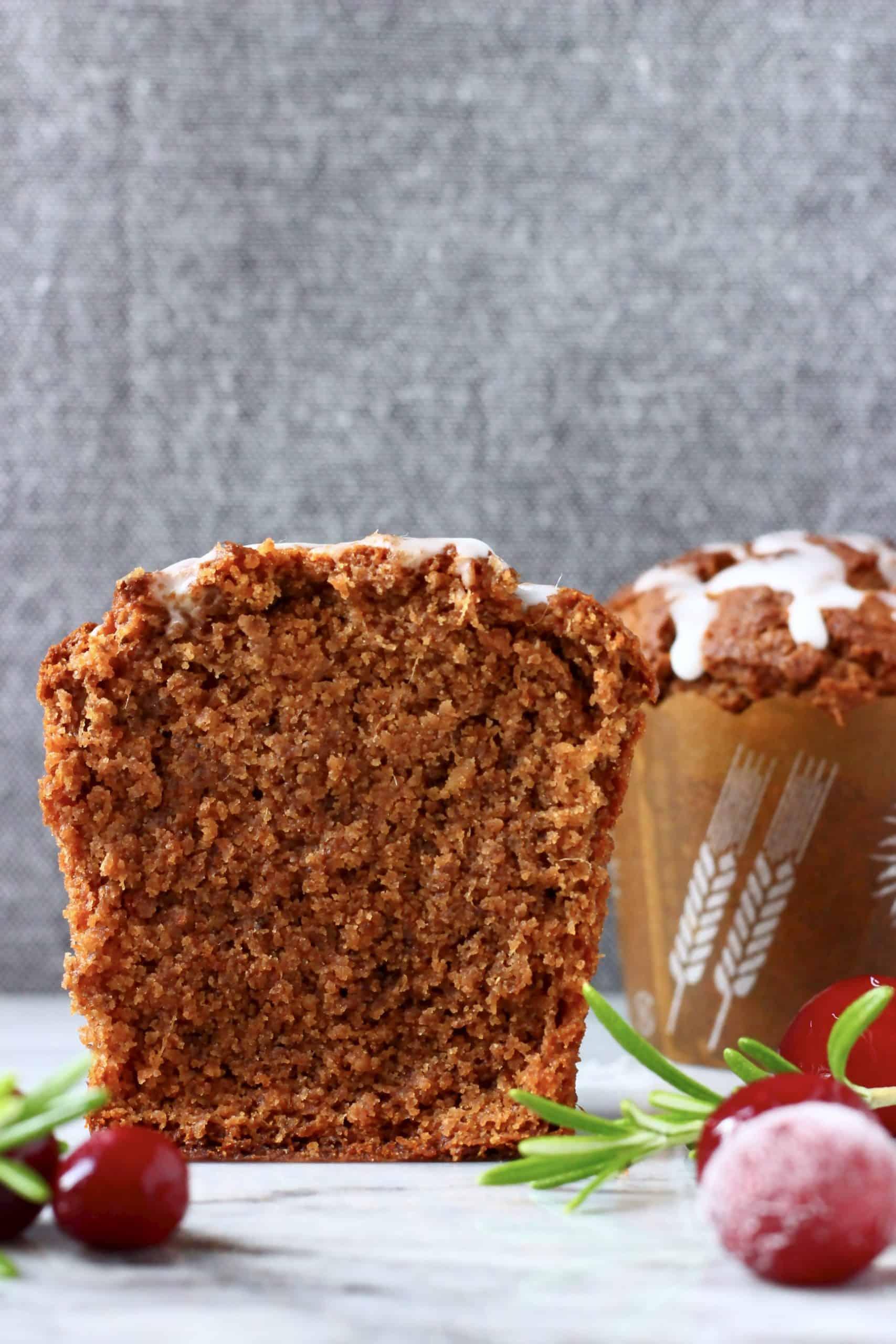 Two gluten-free vegan gingerbread muffins, one sliced in half